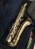 CG Conn Series M Naked Lady brass saxophone and Conn Henri Selmer Paris clarinet