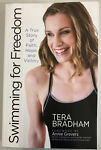 Swimming for Freedom by Tera Bradham foreword by Annie Grevers. Like New