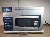 Oster Stainless Steel W Black Finish Countertop Microwave Oven Model Ogym1401