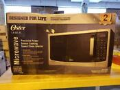 Oster Design For Life 1 6 Cu Ft Stainless Steel 1100 Watt Microwave Oven Counter