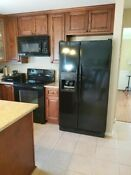 Whirlpool Black Appliance Suite Refrigerator Range Dishwasher And Microwave