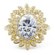 10x8mm Oval Moissanite 14k Yellow Gold Halo Ring