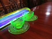 Set Of 2 Vaseline Glass Cups And Saucers. Euc
