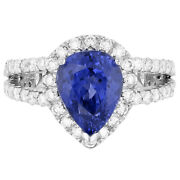 Pear Shaped Tanzanite And Diamond Split Shank Halo Ring In 14kt White Gold