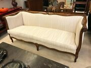 Exposed Wood Frame Loveseat With Nail Head Trim