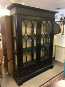 Enclosed Two Door Glass Front Bookcase With Drawers