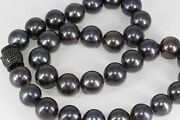 Graduated 12-13mm Fine Plum Shade Black Pearls Necklace With Black Spinel Clasp