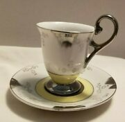 Vintage Japanese Porcelain Tea Cup And Saucer Set - Silver And Yellow Designs