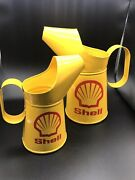 Two Shell Oil Cans