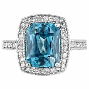 Radiant Cut Blue Zircon And Diamond Halo Ring In 18kt White Gold
