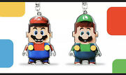 Super Mario From Nintendo Shop And Luigi Keychain From Lego Shop Set. Exclusives