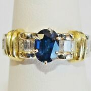 14 Karat Solid Gold 1.48 Ct Oval Sapphire And 0.76 Tcw G Color Vs-1 Diamond Ring