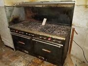 Classic Cast Iron Gas Stove W/9 Burners- As Is