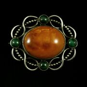 Otto Strange Friis. Art Nouveau Silver Brooch With Amber And Malachite.