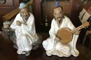 """A Pair Of 6"""" Tall Chinese Mud Man Style Figurines. Mark To Base"""