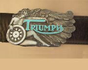Triumph Motorcycle Belt Buckle Is A Winged Woman Playin A Triumph Wheel.