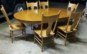Early 1900s Round Tiger Oak Clawfoot Table With 2 Leaves And 6 Antique Chairsandnbsp