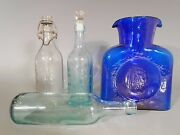Group Of 4 American Glass Articles 3 Bottles And Pitcher Ca. 1900 To 1960