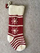 Pottery Barn Knit Stocking With Two Red Jingle Bells Attatched To The Top
