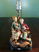 Vintage Colonial Couple Chalk Ware Lamp. 14tall X 8wide