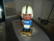 1962 Bobble Head Nodder Baltimore Colts Gold Square Base Football Dark Black