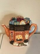Vintage Fireplace Ceramic Teapot Books On Mantle And Cats Sleeping Near Fire