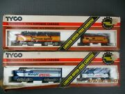 Two Vintage Tyco Ho Locomotives W/matching Cabooses Chessie And Midnight Special