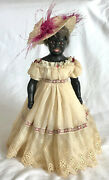 A Unusual And Rare Antique 19th C French Black Bisque Doll With Brown Glass Eyes