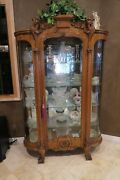 Oak Curio Cabinet With Glass And Griffin Accents