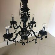 Black Crystal Chandelier In Working Condition, Used, Some Non Noticeable Wear.