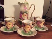 Vintage teapot and 5 cups and saucers. Made in Germany Floral