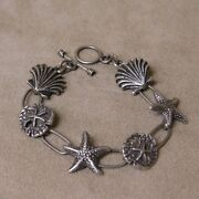 Nautical Link Sterling Silver Bracelet. Scallops, Starfish And Sand Dollars