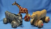 Lot Of 3 Carved Hand Painted Wooden Zebra Lion Giraffe Figurines With Wheels
