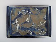 Nils Thorsson For Royal Copenhagen. Large Tray In Glazed Faience With Fishes.