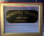 """Vintage Realty Sign """" Sinkhole Realty Office"""" Glass Window Historical Florida"""