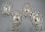 An Unusual Set Of Four Silver-plated Antique Wall Lights