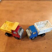 2 Pc. Lot Of Vintage 1970's Marx Dump Trucks, One Blue And White Stake Body, One