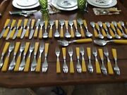 Vintage Supreme Stainless Flatwear. Japan Yellow Handles. Service For 10.