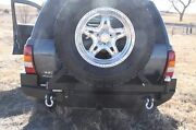 Rock Hard 4x4 Patriot Rear Bumper And Tire Carrier For 99-04 Jeep Grand Cherokee