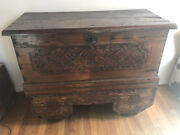 Antique Wooden Chest On Wheels With Carving And Distressed Paint