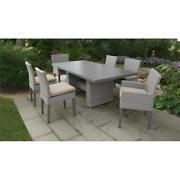 Florence Rectangular Patio Dining Table 4 Armless Chairs 2 Arm Chairs In Wheat