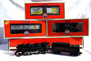 Lionel 4-4-2 Steam Locomotive And Tender With Box Cars And Caboose