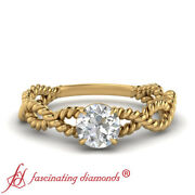 1/2 Carat Round Cut Diamond Solitaire Twisted Engagement Ring In 14k Yellow Gold