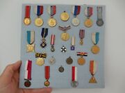 A Collection Of Twenty Four Continental Miniature Dress Medals 20th C Mounted