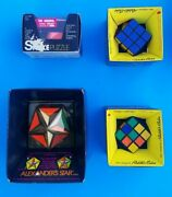 Lot Of 4 Original Rubik's Cubes W/boxes, Alexander's Star Puzzle, And Snake