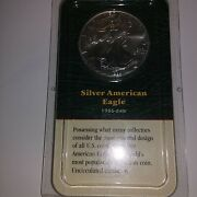 1999 Silver Eagle Dollar In A 1986 Date Holder Littleton Coin Company