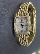 Movado Womens Watch 14kt Yellow Gold White Face Mop Roman Diamond Bezel And Dial