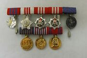 A Court Mounted Group Of Eight Miniature Medals From Yugoslavia 2698