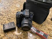 Canon Eos 70d 20.2mp Dslr Camera W/18-55 Mm Is Stm Lens W/battery Grip And Bag