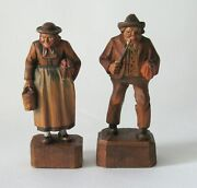 Antique Folk Art Wood Carvings Man And Woman With Umbrellas.